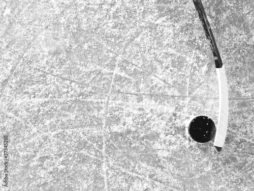 Hockey stick and puck on ice