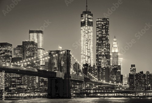 New York by night. Brooklyn Bridge, Lower Manhattan – Black an