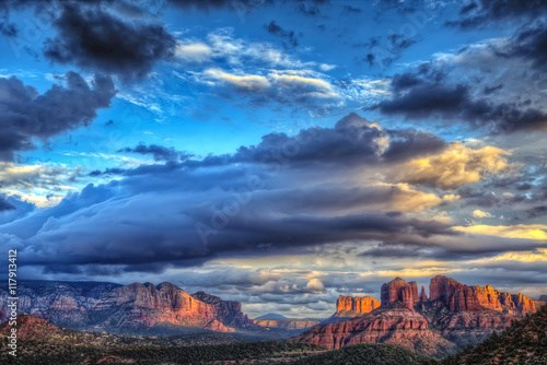 The last rays of sunlight over Sedona Arizona with a building storm moving in.