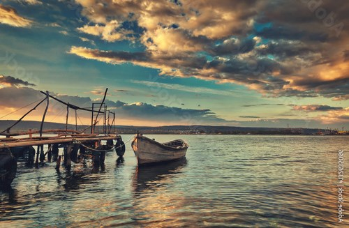 Small dock and fishing boat at fishing village, sunrise shot