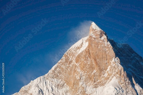 Sunlight on top of Masherbrum mountain peak in a morning, Goro I