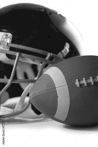 Close up of American football with sports helmet