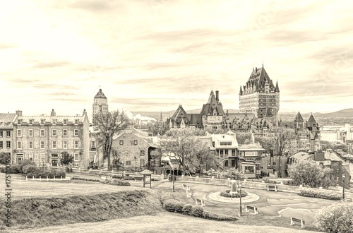 Cityscape or skyline of Chateau Frontenac, park and old town streets during sunset