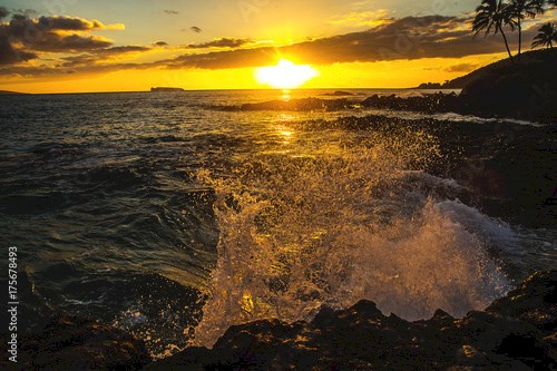 Ocean waves crashing on rocks at a tropical island beach