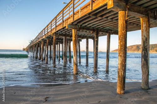 Avila Beach pier view under with waves