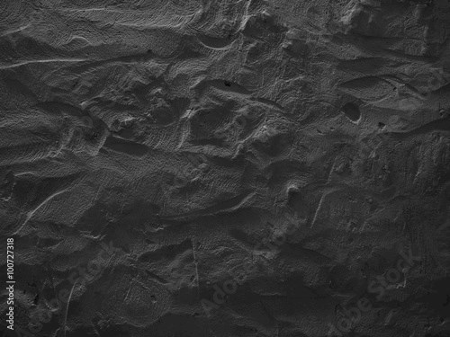 Dramatic dark grey concrete wall background. Raw concrete wall texture, customizable, suitable for background use.