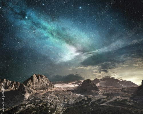 milky way at dawn on a mountain landscape