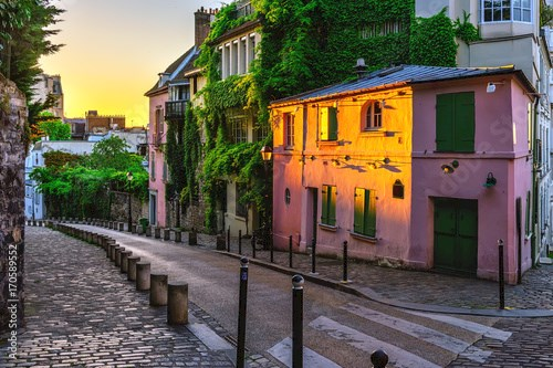 Sunset view of cozy strert in quarter Montmartre in Paris, France