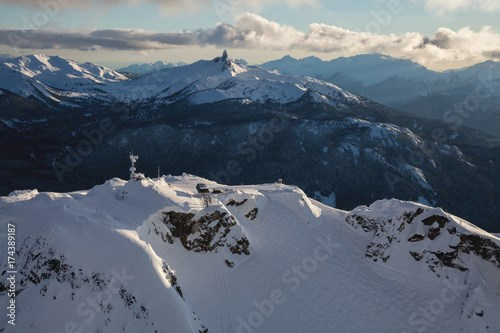 Whistler Mountain, BC, Canada, from an aerial perspective. Picture taken during a cloudy winter sunset.