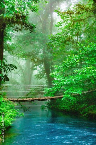 Bridge over blue water of Celeste River in Costa Rica