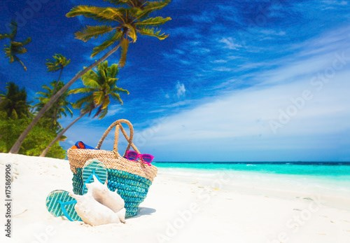beach accessories on turquoise tropical background